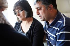 Concerned couple discussing issues with specialist